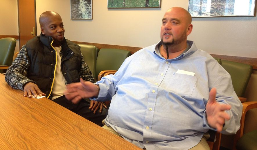 In this Wednesday, Oct. 28, 2015, photo, Lee Aldridge, right, talks about the nine months he's spending in a halfway house ahead of his release from Bureau of Prisons custody next year, after serving several years for conspiracy to distribute cocaine, as Dalemar Nicholson, who was given just two weeks in a halfway house after 10 years in prison, listens in Columbus, Ohio. Aldridge says his extended stay in the halfway house has been a blessing, while Nicholson says he could have used more time to prepare for his release. (AP Photo/Andrew Welsh-Huggins)