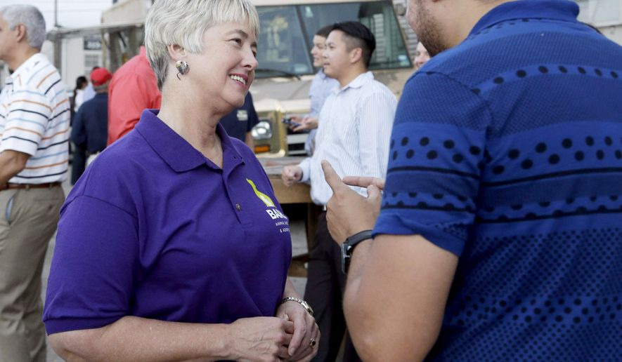 File - In this Oct. 22, 2015 file photo, Houston Mayor Annise Parker, left, greets a supporter at a fund raiser for the Houston Equal Rights Ordinance in Houston. The ordinance that would establish nondiscrimination protections for gay and transgender people in Houston got support this week from some heavy hitters, including the White House and high tech giant Apple. (AP Photo/Pat Sullivan, File)