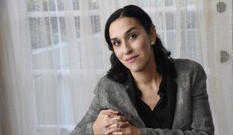 "In this Tuesday, Oct. 20, 2015 photo, Sarah Gavron, director of the film ""Suffragette,"" poses for a portrait at the Four Seasons Hotel in Los Angeles. The movie opens in U.S. theaters on Friday. (Photo by Chris Pizzello/Invision/AP)"