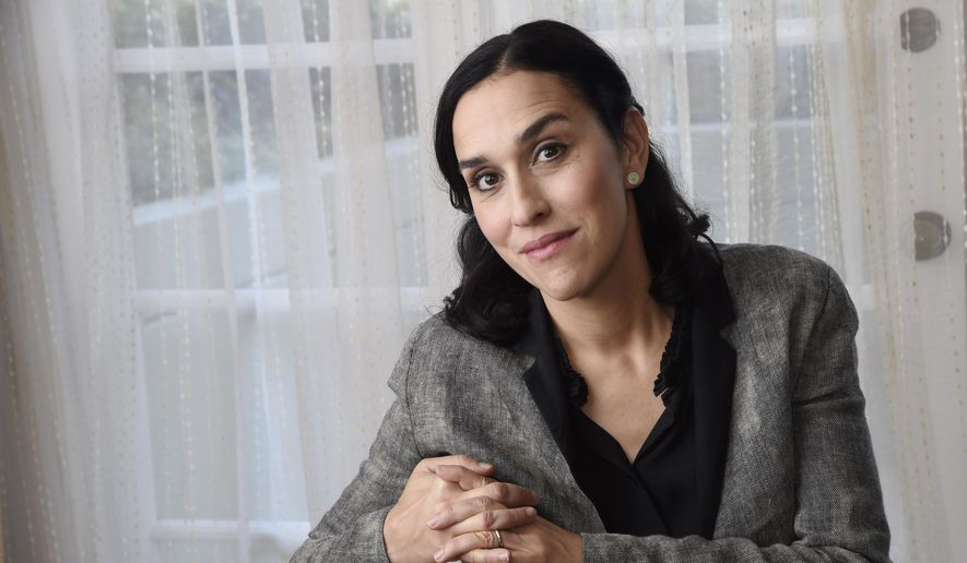 """In this Tuesday, Oct. 20, 2015 photo, Sarah Gavron, director of the film """"Suffragette,"""" poses for a portrait at the Four Seasons Hotel in Los Angeles. The movie opens in U.S. theaters on Friday. (Photo by Chris Pizzello/Invision/AP)"""