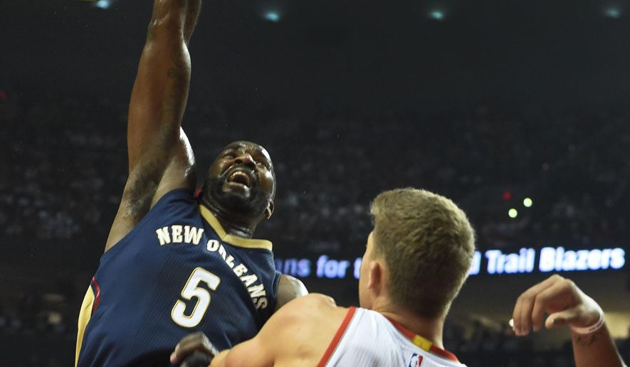 New Orleans Pelicans center Kendrick Perkins (5) shoots the ball over Portland Trail Blazers center Meyers Leonard (11) during the first quarter of an NBA basketball game in Portland, Ore., Wednesday, Oct. 28, 2015. (AP Photo/Steve Dykes)