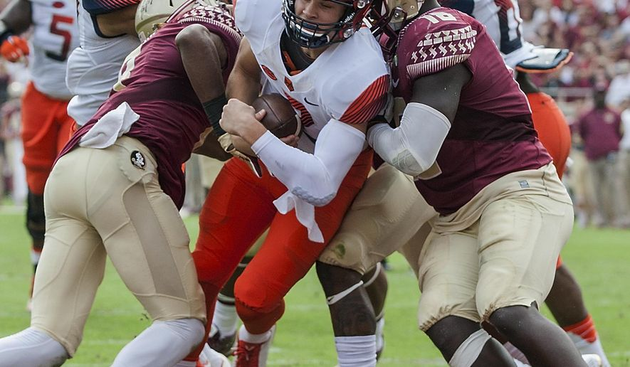 RETRANSMISSION TO CORRECT NAME TO ERIC DUNGEY FROM WAYNE MORGAN - Syracuse quarterback Eric Dungey scores in the first half of an NCAA college football game against Florida State in Tallahassee, Fla., Saturday, Oct. 31, 2015. (AP Photo/Mark Wallheiser)