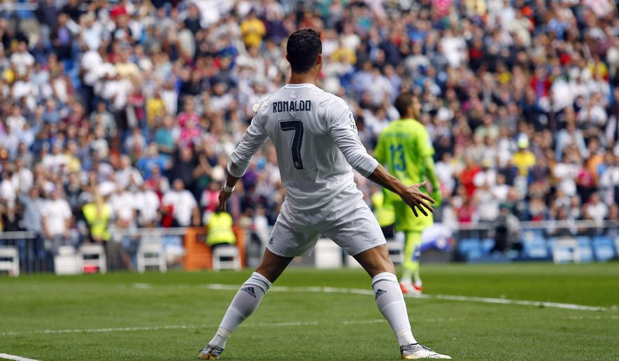 Real Madrid's Cristiano Ronaldo celebrates after scoring his team's second goal against Las Palmas during the Spanish La Liga soccer match between Real Madrid and Las Palmas at the Santiago Bernabeu stadium in Madrid, Saturday, Oct. 31, 2015. (AP Photo/Francisco Seco)