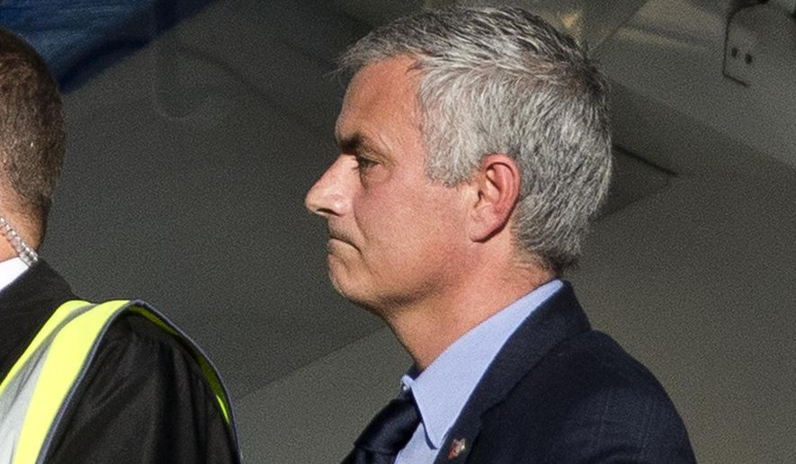 Chelsea's head coach Jose Mourinho watches as Liverpool's Philippe Coutinho scores their first goal to equalize at 1-1 just before halftime during the English Premier League soccer match between Chelsea and Liverpool at Stamford Bridge stadium in London, Saturday, Oct. 31, 2015.  (AP Photo/Matt Dunham)