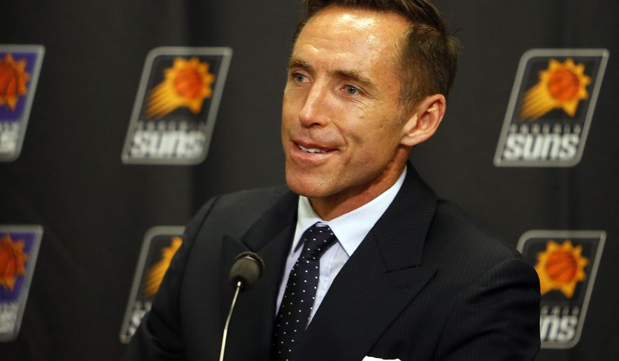 Two-time NBA most valuable player Steve Nash addresses the media prior to an NBA basketball game between the Phoenix Suns and the Portland Trail Blazers, Friday, Oct. 30, 2015, in Phoenix.  Nash will be inducted into the Suns Ring of Honor during the game. (AP Photo/Rick Scuteri)