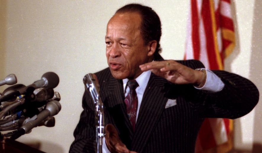 FILE - In this March 30, 1990 file photo, Rep. Gus Savage, D-Ill., speaks at a news conference on Capitol Hill in Washington. Savage, a civil rights activist and journalist who represented a South Side Chicago district for 12 years in the U.S. House, died on Saturday, Oct. 31, 2015, a day after celebrating his 90th birthday. (AP Photo/Charles Tasnadi)