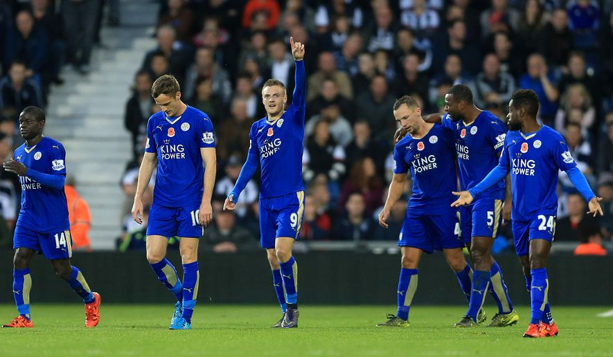 Leicester City's Jamie Vardy, center, celebrates scoring his side's third goal of the game during their English Premier League soccer match against West Bromwich Albion at The Hawthorns, West Bromwich, England, Saturday, Oct. 31, 2015. (Nigel French/PA via AP)     UNITED KINGDOM OUT     -     NO SALES     -     NO ARCHIVES