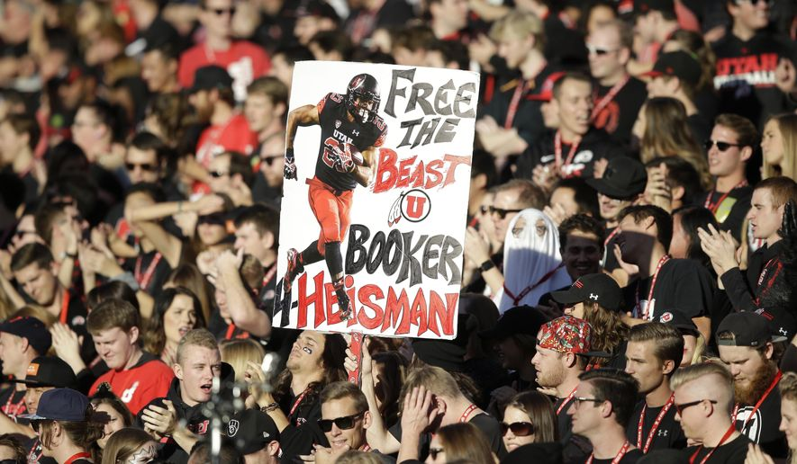 Utah fans show their support for Utah running back Devontae Booker in the first quarter during an NCAA college football game against Oregon State, Saturday, Oct. 31, 2015, in Salt Lake City. (AP Photo/Rick Bowmer)
