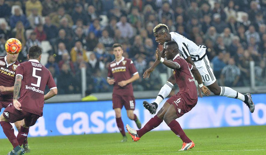 Juventus' Paul Pogba scores a goal during a Serie A soccer match between Juventus and Torino at the Juventus stadium, in Turin, Italy, Saturday, Oct. 31, 2015. (AP Photo/ Massimo Pinca)