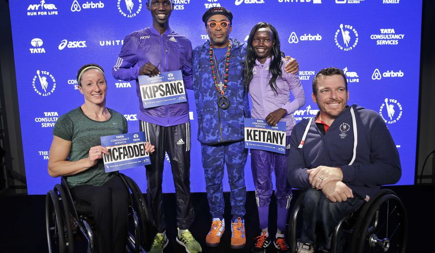 New York City Marathon 2014 champions Kurt Fearnley, right, Mary Keitany second from right, Wilson Kipsang, second from left, and Tatyana McFadden, left, pose for a picture with marathon grand marshal Spike Lee, center, during a news conference in New York, Thursday, Oct. 29, 2015. The marathon will be run on Nov. 1, 2015. (AP Photo/Seth Wenig)