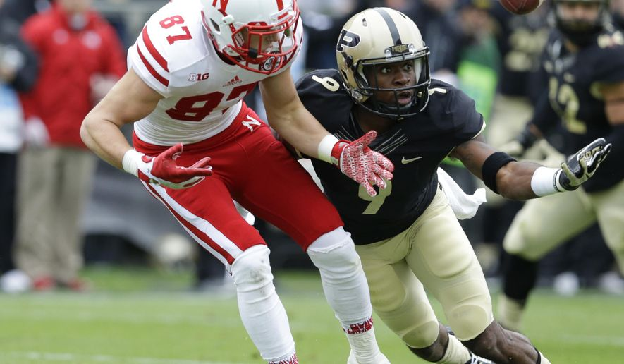 Purdue cornerback Anthony Brown (9) breaks up a pass intended for Nebraska wide receiver Brandon Reilly (87) during the first half of an NCAA college football game in West Lafayette, Ind., Saturday, Oct. 31, 2015. (AP Photo/Michael Conroy)