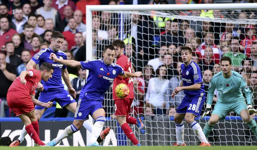 Liverpool's Philippe Coutinho, left, scores his side's second goal of the game during the English Premier League soccer match between Chelsea and Liverpool at Stamford Bridge stadium in London, Saturday, Oct. 31, 2015. (Adam Davy/PA via AP)  UNITED KINGDOM OUT
