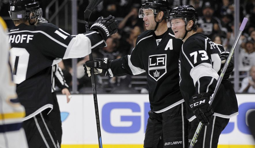 Los Angeles Kings defenseman Christian Ehrhoff (10), of Germany, celebrates with center Jeff Carter, center, on a goal by center Tyler Toffoli (73) during the second period of an NHL hockey game against the Nashville Predators in Los Angeles, Saturday, Oct. 31, 2015. (AP Photo/Alex Gallardo)