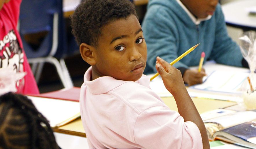 In this Oct. 28, 2015, photograph, Walton Elementary second grader Courtavious Russell looks around his class as he waits for the next question in his language arts class at this Jackson, Miss., school. Walton and Mississippi's 1,000 other public schools have been affected by a variety of changes supported by the current Legislature. And with the general election only days away, a new batch of lawmakers could affect additional changes ranging from funding to expanding eligible areas for charter schools to rewriting the state's funding formula. (AP Photo/Rogelio V. Solis)