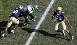 Navy quarterback Keenan Reynolds, right, rushes the ball as teammate Calvin Cass, left, blocks South Florida linebacker Auggie Sanchez in the first half of an NCAA college football game, Saturday, Oct. 31, 2015, in Annapolis, Md. (AP Photo/Patrick Semansky)