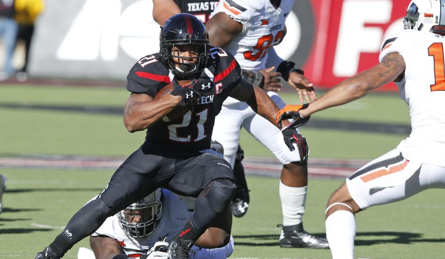Texas Tech running back DeAndre Washington (21) carries in the second quarter of an NCAA college football game against Oklahoma State in Lubbock, Texas, Saturday, Oct. 31, 2015. (AP Photo/Sue Ogrocki)