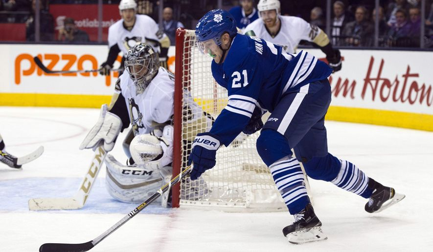 Pittsburgh Penguins' goaltender Marc-Andre Fleury, left, keeps an eye on Toronto Maple Leafs' James van Riemsdyk during second period NHL action, in Toronto, on Saturday, Oct. 31, 2015. (Kevin Van Paassen/The Canadian Press via AP)