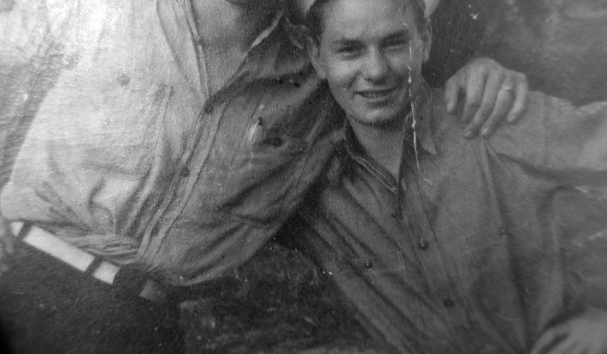 In this circa 1945 Solt family photo courtesy of Nadean Lescoe, Lescoe's father Dean Solt, poses at right with Alan Sperry when both Utah natives were stationed in the Philippines in World War II. Some say it was a remarkable coincidence, but the two veterans who took part in a Sept. 10 Utah Honor Flight to Washington, D.C., believe it was more than that. Sperry, of Provo, and Solt, of Salt Lake City, hadn't seen each other for seven decades. Yet both men ended up seated next to each other during the Honor Flight event.   (Solt Family courtesy of Nadean Lescoe via AP)