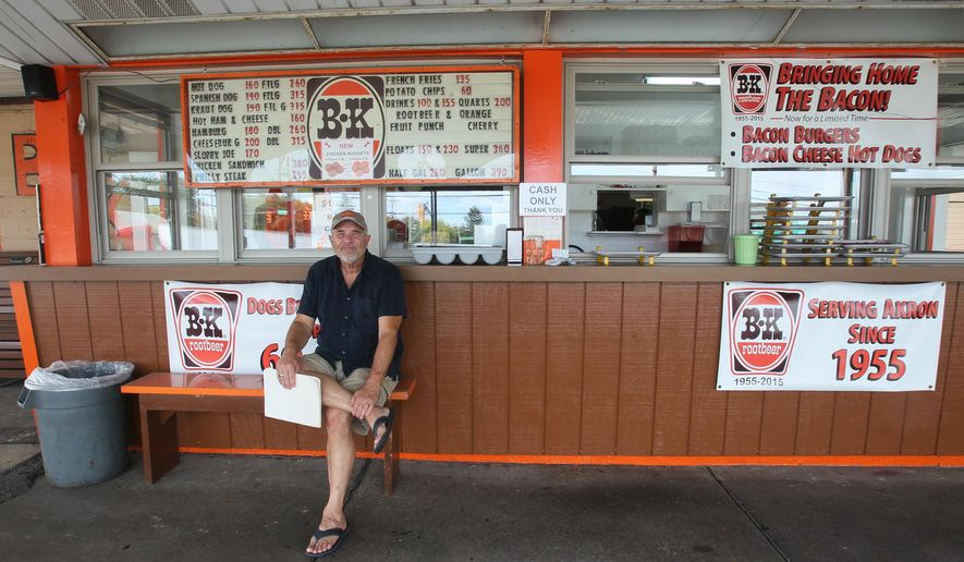 """In this October 2015 photo, Jeff Fulkman, owner of B&K Rootbeer, poses for a photo in Akron, Ohio. For 60 years, customers have been coming back to the B&K Root Beer for the curbside treats, including the iconic dog with """"Spanish sauce"""" and homemade root beer. (Mike Cardew/Akron Beacon Journal via AP)  MANDATORY CREDIT"""