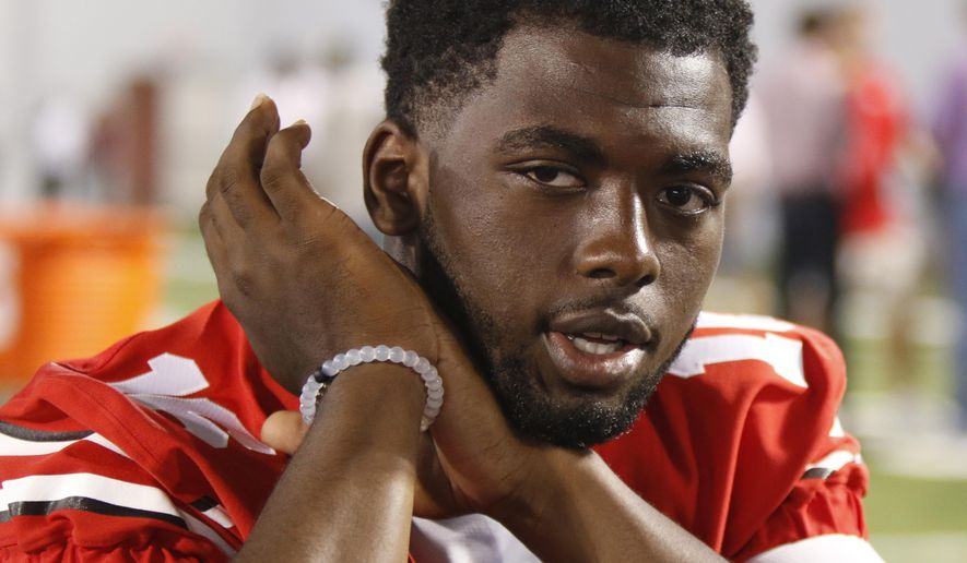 IFLE - In this Aug. 16, 2015, file photo, Ohio State quarterback J.T. Barrett speaks to reporters during the university's NCAA college football media day in Columbus, Ohio. Ohio State quarterback J.T. Barrett has been suspended for one game after being cited with a misdemeanor offense of operating a vehicle under the influence.A statement from the school says Barrett was stopped at a Columbus police check point early Saturday morning, Oct. 31, 2015. (AP Photo/Paul Vernon, File)
