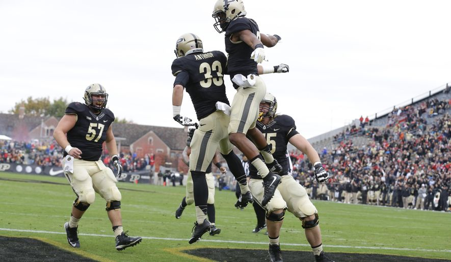 Purdue wide receiver Danny Anthrop (33) celebrates a touchdown with wide receiver Gregory Phillips (20) during the first half of an NCAA college football game against Nebraska in West Lafayette, Ind., Saturday, Oct. 31, 2015. (AP Photo/Michael Conroy)