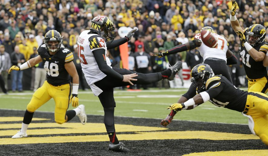 Iowa's Aaron Mends, right, blocks a punt by Maryland punter Nicolas Pritchard in the end zone during the first half of an NCAA college football game, Saturday, Oct. 31, 2015, in Iowa City, Iowa. (AP Photo/Charlie Neibergall)