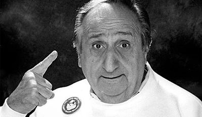 "In this file photo, date not known, actor Al Molinaro points to a plastic duck on his head, while promoting a fund-raising event in his hometown of Kenosha, Wis. Molinaro, the loveable character actor with the hangdog face who was known to millions of TV viewers for playing Murray the cop on ""The Odd Couple"" and malt shop owner Al Delvecchio on ""Happy Days,"" died Friday, Oct. 30, 2015, at Verdugo Hills Hospital in Glendale, Calif., at age 96. (Kenosha News via AP, File)"