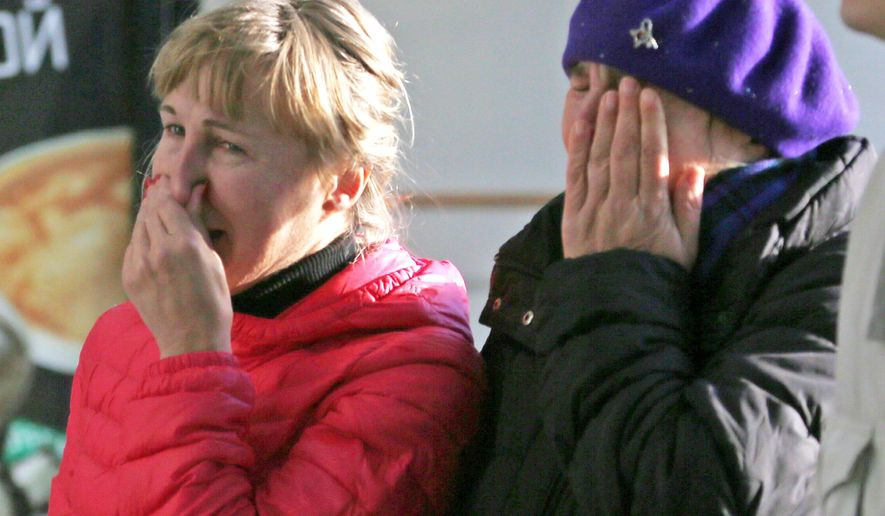 Relatives of a passenger aboard the crashed Russian airliner with 217 passengers and seven crew aboard, as people gather at Pulkovo airport in St.Petersburg, Russia, Saturday, Oct. 31, 2015. Russia's civil air agency is expected to have a news conference shortly to talk about the Russian Metrojet passenger plane that Egyptian authorities say has crashed in Egypt's Sinai peninsula. (AP Photo/Dmitry Lovetsky)