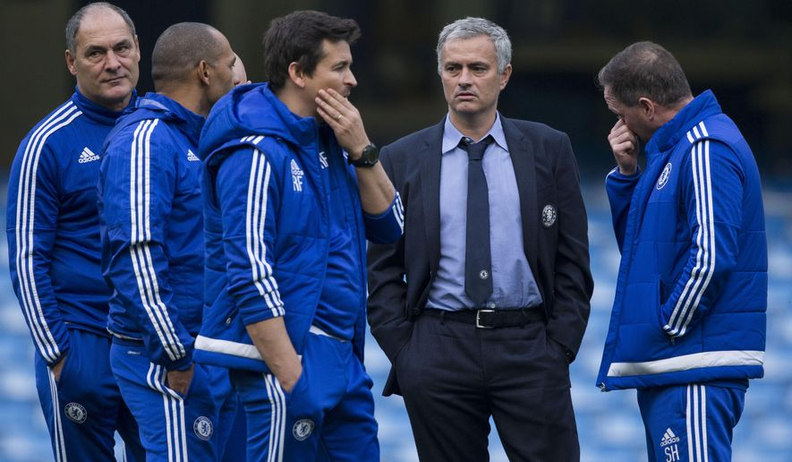 Chelsea's head coach Jose Mourinho, second right, talks with his coaching staff after coming back out onto the pitch after the English Premier League soccer match between Chelsea and Liverpool at Stamford Bridge stadium in London, Saturday, Oct. 31, 2015.  Liverpool won the match 3-1.  (AP Photo/Matt Dunham)