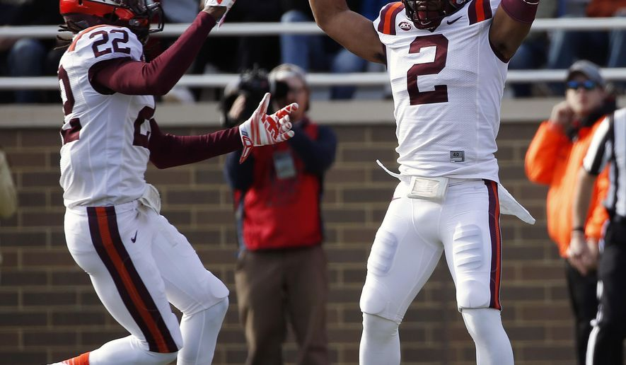 Virginia Tech safety Donovan Riley (2) celebrates with teammate fullback Trey Skeens (22) after recovering a punt to Boston College during the second quarter of an NCAA college football game in Boston, Saturday, Oct. 31, 2015. (AP Photo/Michael Dwyer)