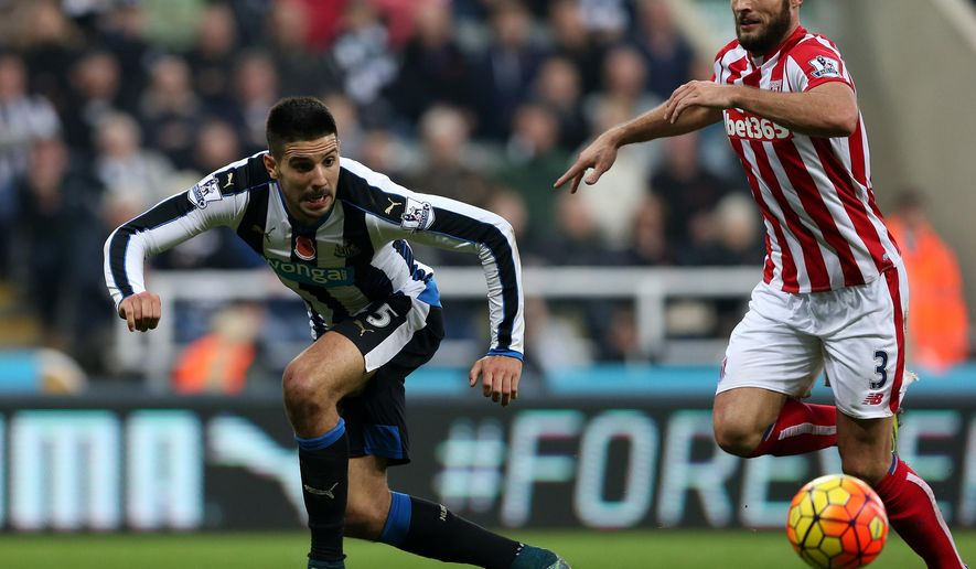 Newcastle United's Aleksandar Mitrovic, left, vies for the ball with  Stoke City's Eric Pieters, right, during their English Premier League soccer match between Newcastle United and Stoke City at St James' Park, Newcastle, England, Saturday, Oct. 31, 2015. (AP Photo/Scott Heppell)