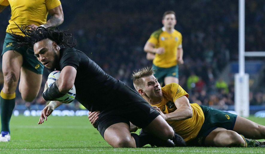 New Zealand's Ma'a Nonu scores a try during the Rugby World Cup final between New Zealand and Australia at Twickenham Stadium in London,  Saturday, Oct. 31, 2015. (AP Photo/Tim Ireland)