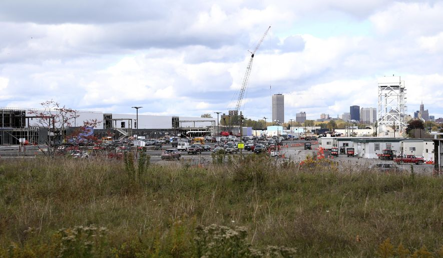 "In this Saturday, Oct. 17, 2015 photo, construction work continues at a high-tech manufacturing site in Buffalo, N.Y. New York is committing $750 million to the factory for Elon Musk's SolarCity in exchange for a promise of 3,000 jobs and a $5 billion investment in manufacturing solar panels. It's a centerpiece of Gov. Andrew Cuomo's ""Buffalo Billion"" campaign. But the plant is slated to be coming online as federal subsidies for solar installations begin to phase out.  (AP Photo/Mike Groll)"