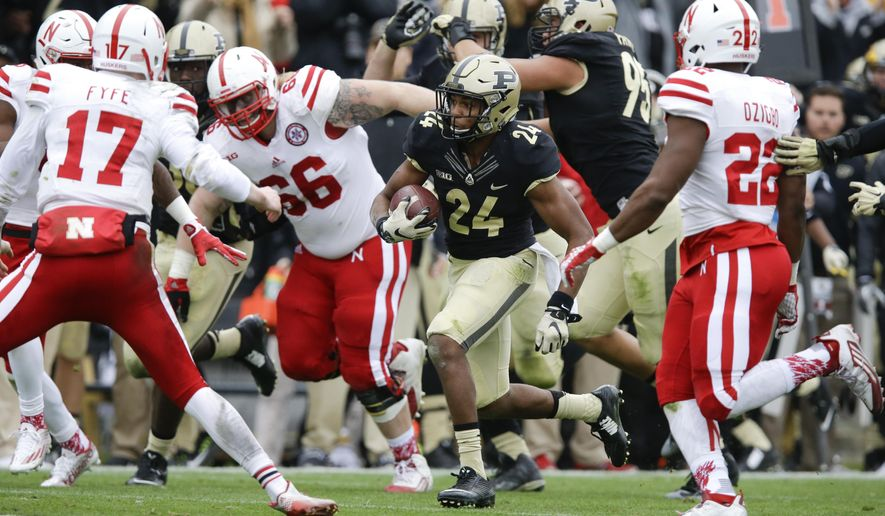 Purdue cornerback Frankie Williams (24) returns an interception of a pass from Nebraska quarterback Ryker Fyfe (17) during the second half of an NCAA college football game in West Lafayette, Ind., Saturday, Oct. 31, 2015. Purdue defeated Nebraska 55-45. (AP Photo/Michael Conroy)