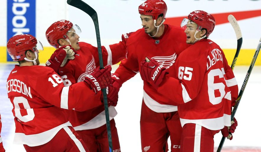Detroit Red Wings' Jonathan Ericsson (52), second from right, celebrates his goal against the Ottawa Senators with teammates, from left to right, Joakim Andersson (18), Teemu Pulkkinen (56) and Danny DeKeyser (65) during second period NHL hockey action, in Ottawa, on Saturday, Oct. 31, 2015. (Fred Chartrand/The Canadian Press via AP)