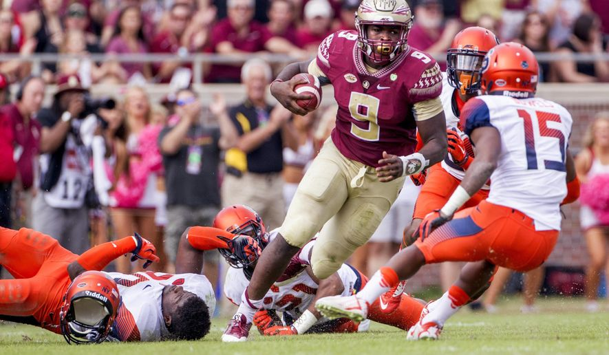 Florida State running back Jacques Patrick cuts through the Syracuse defense in the first half of an NCAA college football game in Tallahassee, Fla., Saturday, Oct. 31, 2015. (AP Photo/Mark Wallheiser)