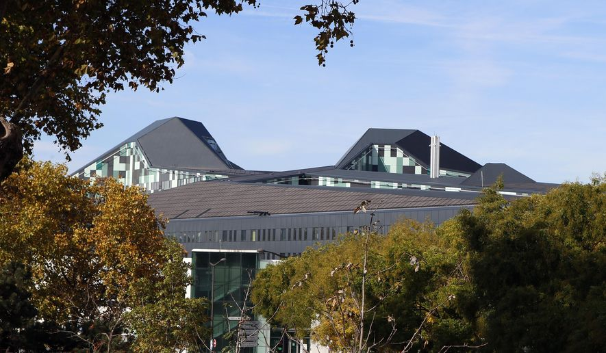 General view of the new building of the French Defense Ministry at Balard district, in Paris, Friday, Oct, 30, 2015. The building's walls are designed to withstand a missile strike and a highly secured operational room is hidden underground. After a particularly dangerous year, French army chiefs are moving into their new defense ministry, dubbed the French Pentagon, aimed at a quicker response to terrorism and other threats. (AP Photo/Francois Mori)