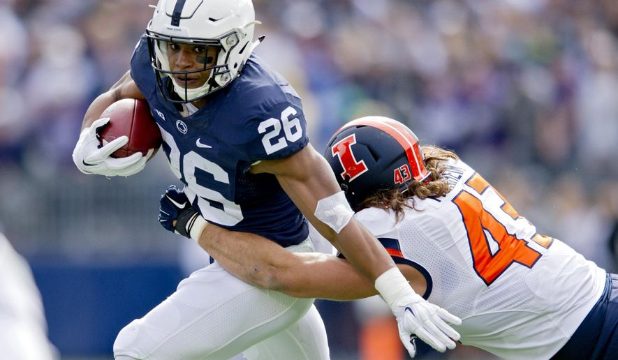 Penn State running back Saquon Barkley dodges Illinois linebacker Mason Monheim  during an NCAA college football game in State College, Pa., Saturday, Oct. 31, 2015. Penn State won 39-0.  (Abby Drey/Centre Daily Times via AP) MANDATORY CREDIT; MAGS OUT