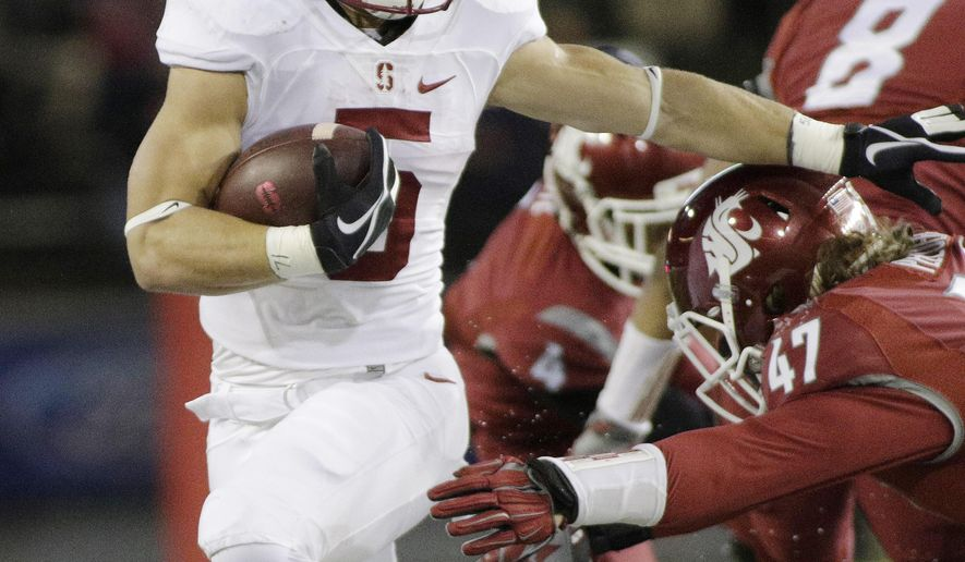 Stanford running back Christian McCaffrey (5), runs against Washington State linebacker Peyton Pelluer (47) during the first half of an NCAA college football game, Saturday, Oct. 31, 2015, in Pullman, Wash. (AP Photo/Young Kwak)