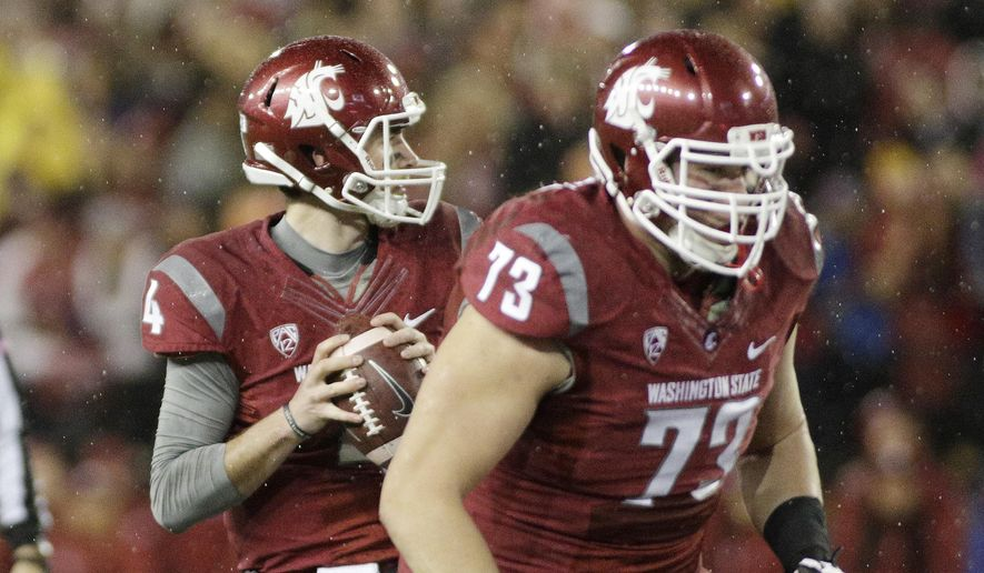 Washington State quarterback Luke Falk (4) looks for a receiver during the first half of an NCAA college football game against Stanford, Saturday, Oct. 31, 2015, in Pullman, Wash. (AP Photo/Young Kwak)