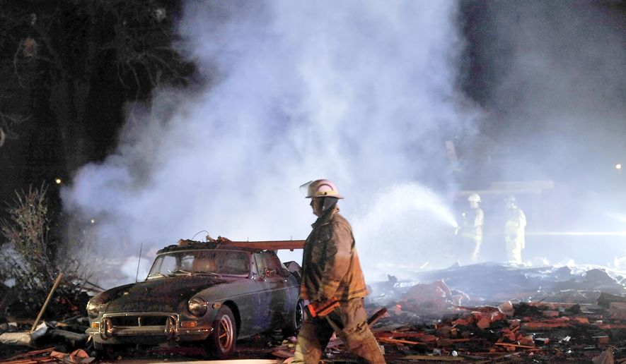 Redford Township fire department crews work the scene of a house explosion in Redford Township, Mich., on Sunday, Nov. 1, 2015. According to authorities and eyewitnesses, the blast happened around 6 p.m. Sunday. (Robin Buckson/Detroit News via AP)  DETROIT FREE PRESS OUT; HUFFINGTON POST OUT; MANDATORY CREDIT