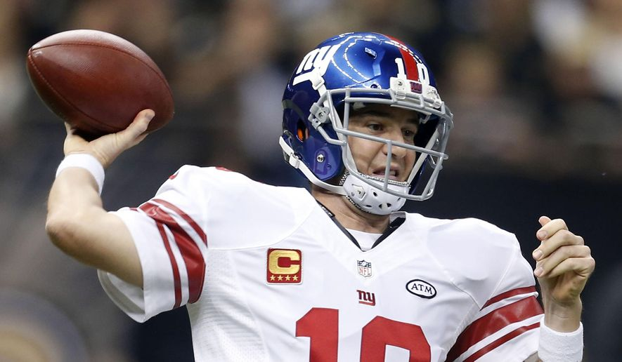 New York Giants quarterback Eli Manning (10) passes in the first half of an NFL football game against the New Orleans Saints in New Orleans, Sunday, Nov. 1, 2015. (AP Photo/Butch Dill)