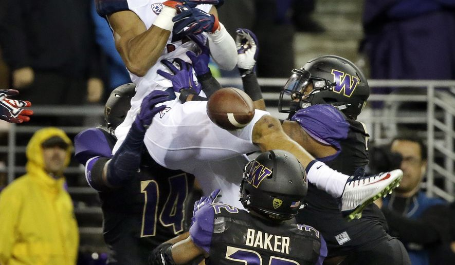 Arizona wide receiver Trey Griffey drops a pass in the end zone against Washington to end the first half an NCAA college football game Saturday, Oct. 31, 2015, in Seattle. (AP Photo/Elaine Thompson)
