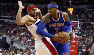 Washington Wizards guard Jared Dudley (1) guards New York Knicks forward Carmelo Anthony (7) in the first half of an NBA basketball game, Saturday, Oct. 31, 2015, in Washington. (AP Photo/Alex Brandon)