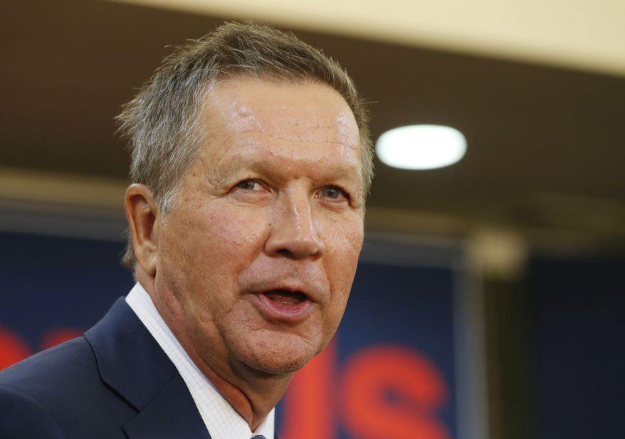 John Kasich has made his record of balancing the federal budgets when he was a congressman and of balancing the budget in Ohio the cornerstone of his campaign. He has promised to do it again if elected president and to do it in eight years. (Associated Press)