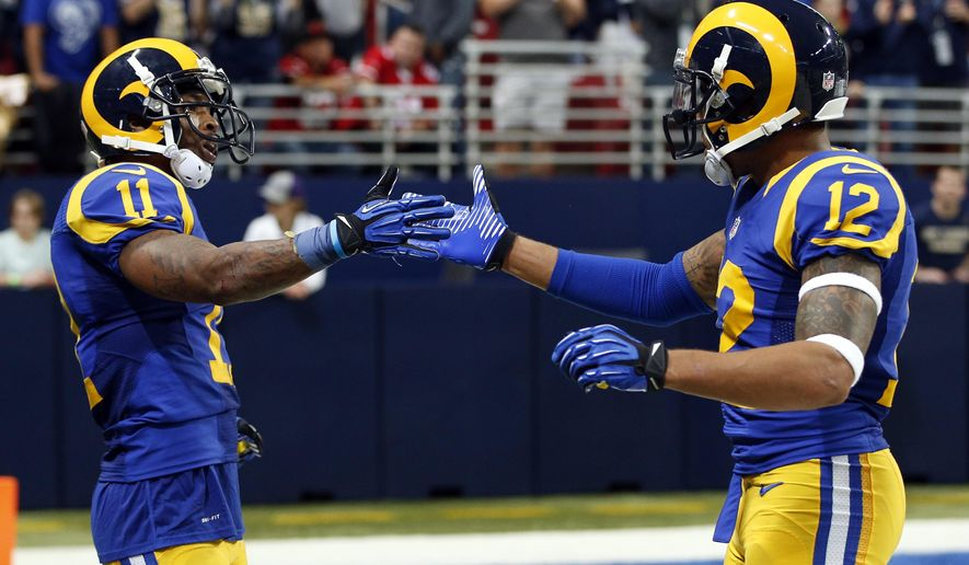 St. Louis Rams wide receiver Tavon Austin,  left, is congratulated by teammate Stedman Bailey, right, after catching a short pass and running it in for a touchdown during the fourth quarter of an NFL football game against the San Francisco 49ers, Sunday, Nov. 1, 2015, in St. Louis. (AP Photo/Billy Hurst)