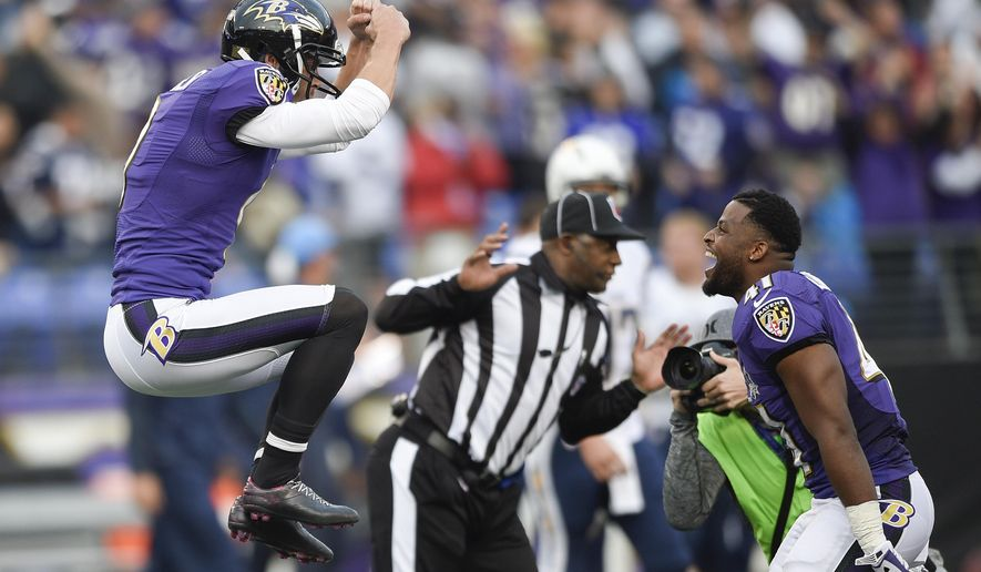 Baltimore Ravens kicker Justin Tucker (9) celebrates his game winning field goal with teammate cornerback Anthony Levine (41) during the second half of an NFL football game against the San Diego Chargers in Baltimore, Sunday, Nov. 1, 2015. The Ravens defeated the Chargers 29-26. (AP Photo/Nick Wass)