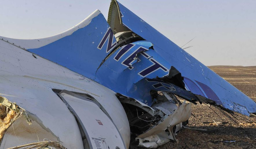 This photo released by the Prime Minister's office shows the tail of a Metrojet plane that crashed in Hassana, Egypt on Saturday, Oct. 31, 2015. The Russian aircraft carrying 224 people crashed Saturday in a remote mountainous region in the Sinai Peninsula about 20 minutes after taking off from a Red Sea resort popular with Russian tourists, the Egyptian government said. There were no survivors. (Suliman el-Oteify/Egyptian Prime Minister's Office via AP)