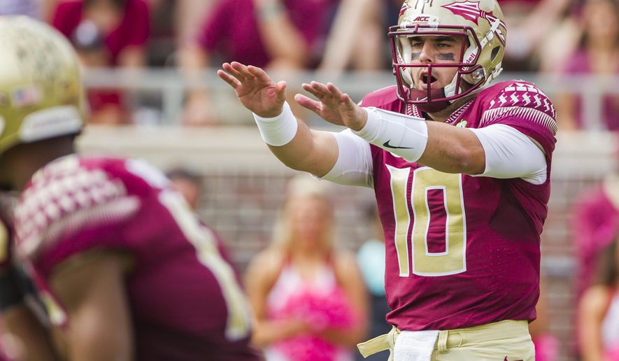 Florida State quarterback Sean Maguire at the line in the first half of an NCAA college football game against Syracuse in Tallahassee, Fla., Saturday, Oct. 31, 2015. Florida State defeated Syracuse 45-21. (AP Photo/Mark Wallheiser)