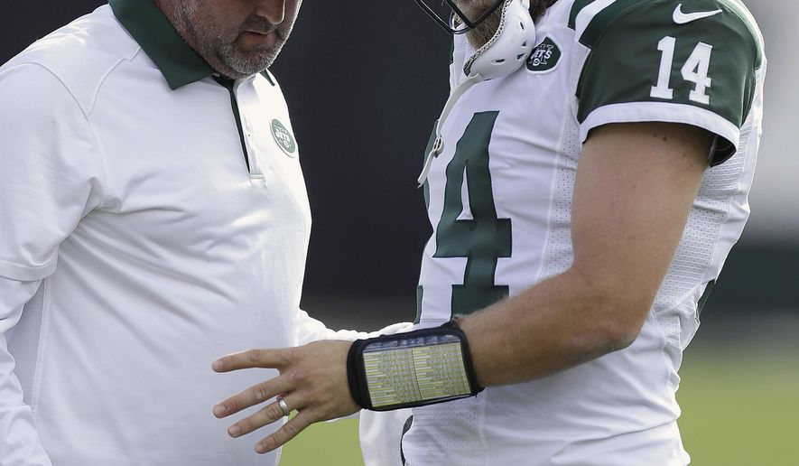 New York Jets quarterback Ryan Fitzpatrick (14) has his left hand looked at during the first half of an NFL football game against the Oakland Raiders in Oakland, Calif., Sunday, Nov. 1, 2015. (AP Photo/Ben Margot)